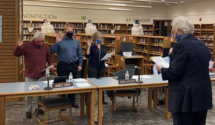 Sunman-Dearborn Community School's attorney Frank Kramer, right, swears in, from left, Robert (Scot) Davis, James Graf, and Sara Hylton for another term on the board.  Submitted Photo