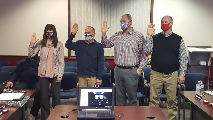 Four new board members were sworn in at the Jan. 12 South Dearborn Community School Corporation board meeting. From left are Kelli Gentrup-Pettit, Daryl Cutter, Steve Hamlett, and Chris Daugherty. Board attorney Larry Eaton swore the four in. Submitted Photo